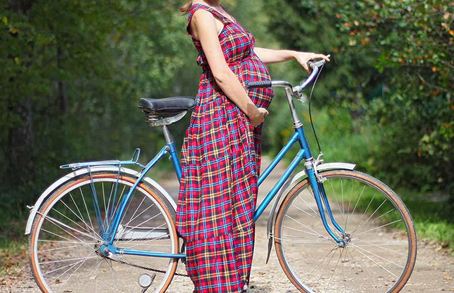 can you ride a bike during early pregnancy or after giving birth